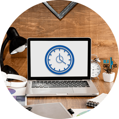 Blucactus - Keep your website light - A laptop and a clock on its screen